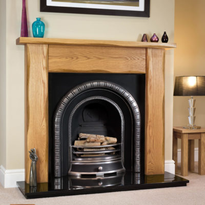 Waney Edge Straight Oak fireplace surround shown in a light oak finish with a Henley cast iron arch insert